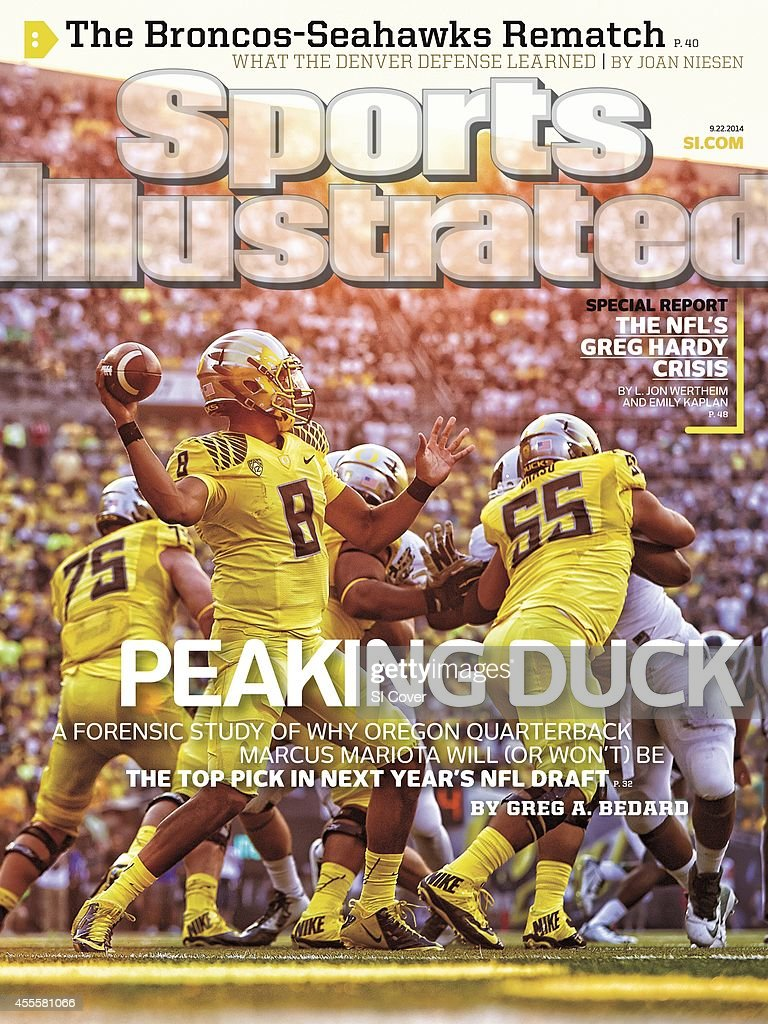 September 22 2014 Sports Illustrated Cover Oregon QB Marcus Mariota in action pass vs Michigan State at Autzen Stadium Eugene OR CREDIT Jonathan...