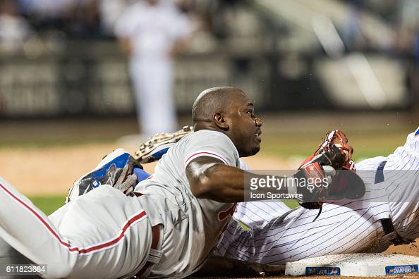 Philadelphia Phillies First base Ryan Howard [3800] dives to the bag after the ball hits pitcher Luis Garcia and bounces towards first base to retire...