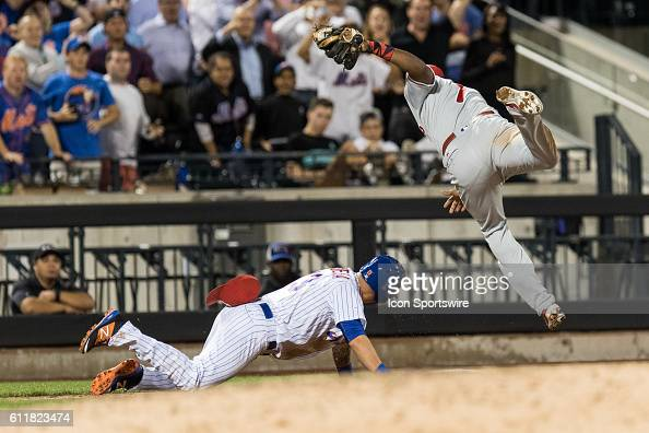Philadelphia Phillies Third base Maikel Franco [9867] dives over New York Mets Shortstop Asdrubal Cabrera [6195] after Cabrera stumbles going back to...