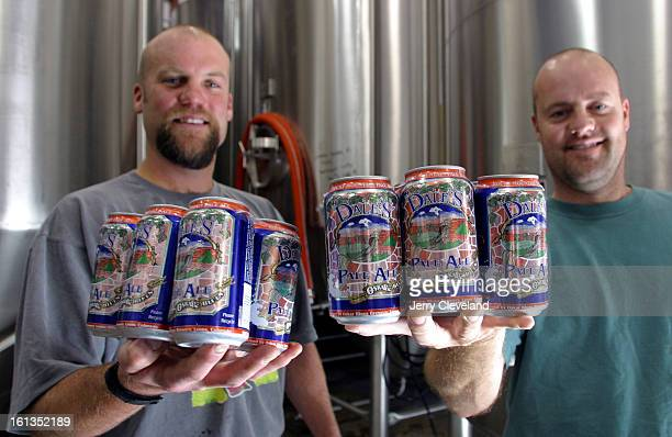 LYONS COLO September 24 2003 Dale Katechis <cq> left owner and Brian Lutz <cq> brewmaster hold freshly canned sixpacks of Dale's Pale Ale <cq> in the...
