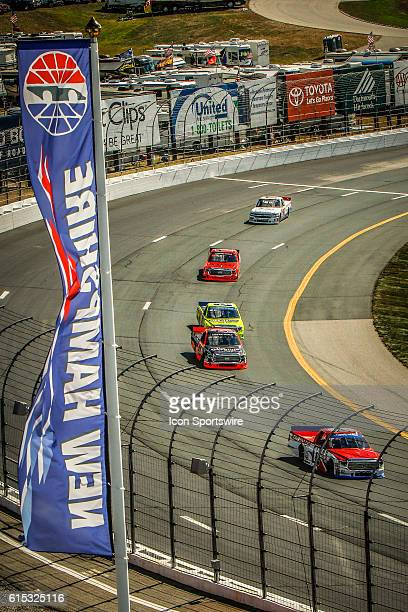 Cars drive through turn 3 during the NASCAR Camping World Series Keystone Light race at New Hampshire Motor Speedway in Loudon NH