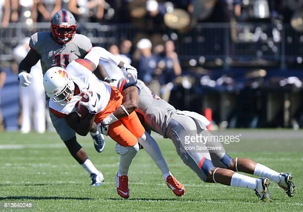 Syracuse Orange wide receiver Ervin Philips is tackled by UConn Huskies safety Obi Melifonwu as the Syracuse Orange take on the UConn Huskies at...