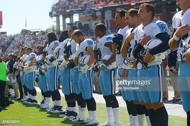 Tennessee Titans Players place their right hands over their heart in respect for the National Anthem during pregame action The Tennessee Titans were...