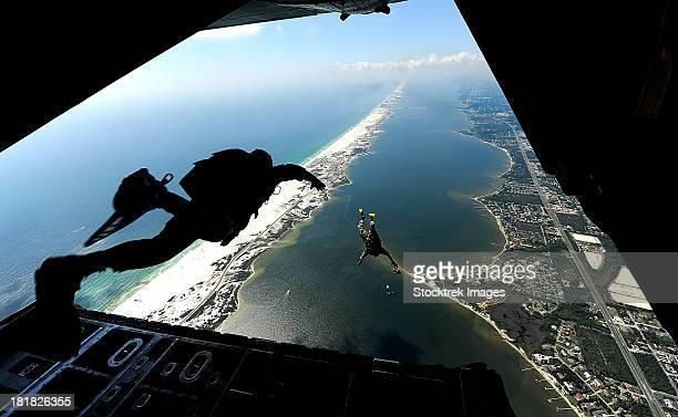 September 27, 2010 - U.S. Airmen jump out of a C-130 Hercules aircraft during parachute training at Santa Rosa Sound, Florida.