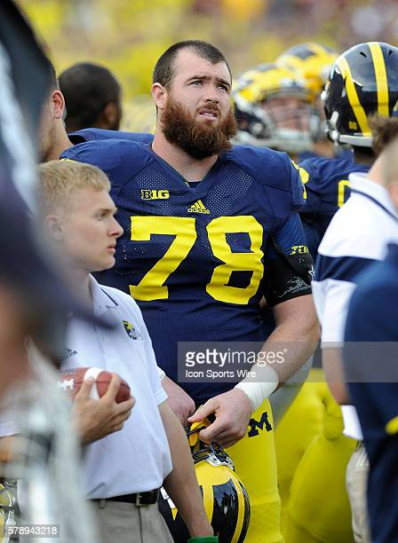 Michigan offensive lineman Erik Magnuson watches from the sideline as the Wolverines lose their second straight home game this time a 3014 loss to...