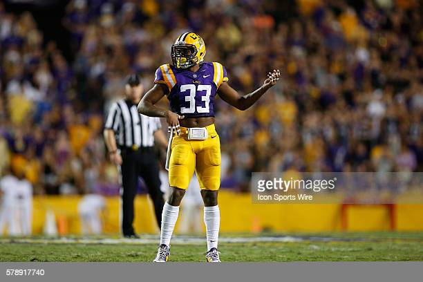 Safety Jamal Adams of the LSU Tigers does an air guitar gesture during a game against the New Mexico State Aggies at Tiger Stadium in Baton Rouge LA