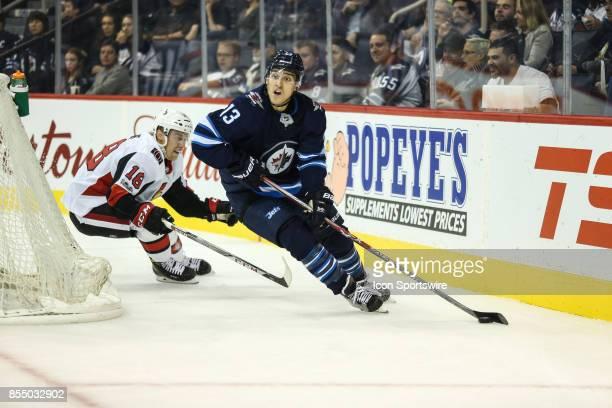 Winnipeg Jets forward Brandon Tanev skates away from Ottawa Senators forward Clarke MacArthur during the NHL game between the Winnipeg Jets and the...