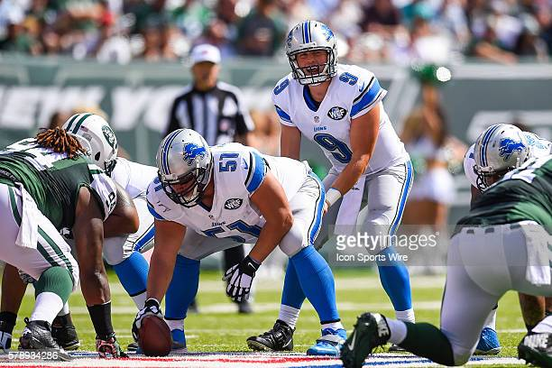 Detroit Lions quarterback Matthew Stafford lines over Detroit Lions center Dominic Raiola during the first half of a NFL matchup between the Detroit...