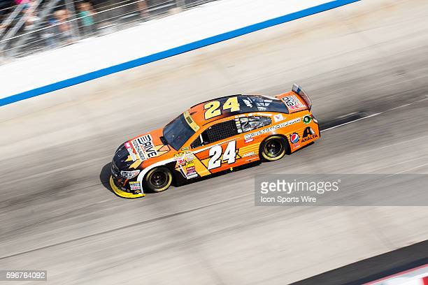 NASCAR Chase contender Jeff Gordon driver of the Drive To End Hunger Chevrolet wins the NASCAR Sprint Cup Series AAA 400 at Dover International...