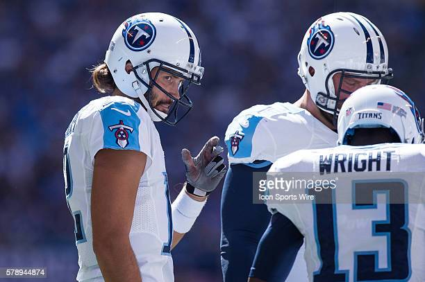 Tennessee Titans quarterback Charlie Whitehurst waits for the play call to come in from the sidelines in the huddle with Tennessee Titans wide...