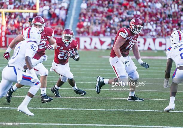 Arkansas Razorbacks running back Rawleigh Williams III follows blocks by Arkansas Razorbacks offensive lineman Dan Skipper and Arkansas Razorbacks...