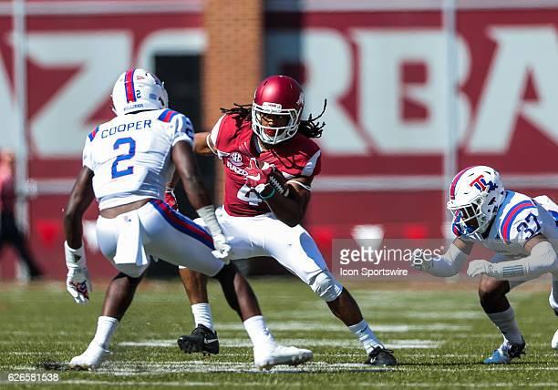 Arkansas Razorbacks wide receiver Keon Hatcher tries to evade Louisiana Tech Bulldogs safety Secdrick Cooper and Louisiana Tech Bulldogs cornerback...