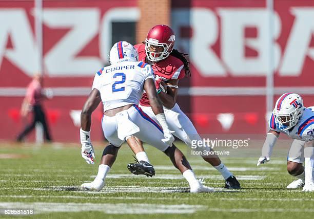 Arkansas Razorbacks wide receiver Keon Hatcher tries to get around Louisiana Tech Bulldogs safety Secdrick Cooper during an NCAA football game...