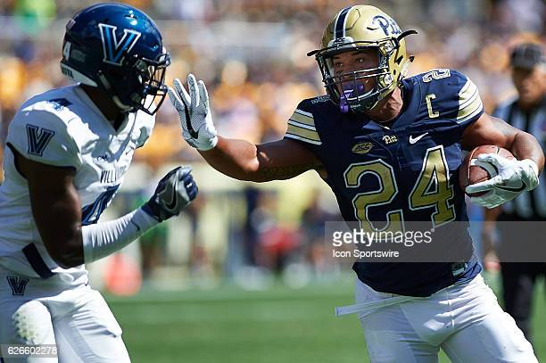 Pittsburgh Panthers running back James Conner stiff arms a defender before scoring a touchdown during a NCAA football game between the Pittsburgh...