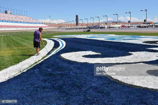 Painters make final infield logo touchups during the NASCAR Camping World Truck Series DC Solar 350 at Las Vegas Motor Speedway Las Vegas NV