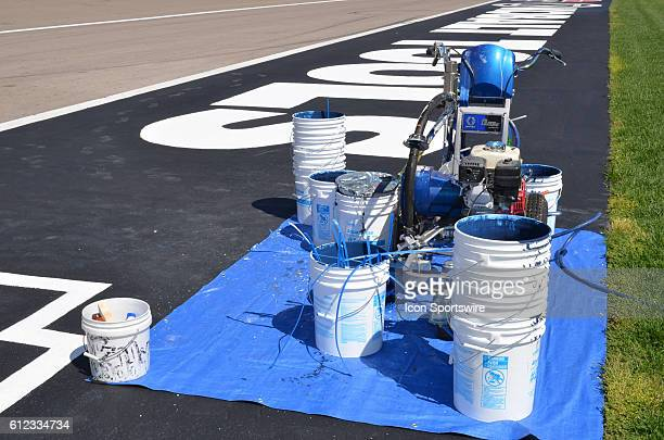 Plenty of paint is needed to complete the infield logos during the NASCAR Camping World Truck Series DC Solar 350 at Las Vegas Motor Speedway Las...