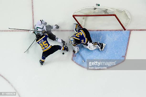 St Louis Blues defenseman Chris Butler forces Dallas Stars center Justin Dowling off the puck as St Louis Blues goalie Jake Allen makes the save...