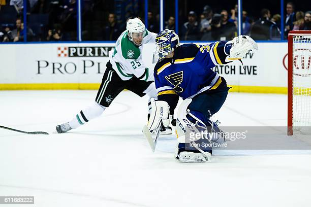 St Louis Blues goalie Pheonix Copley slides across to make a save on Dallas Stars right wing Brett Ritchie during the third period of a NHL hockey...