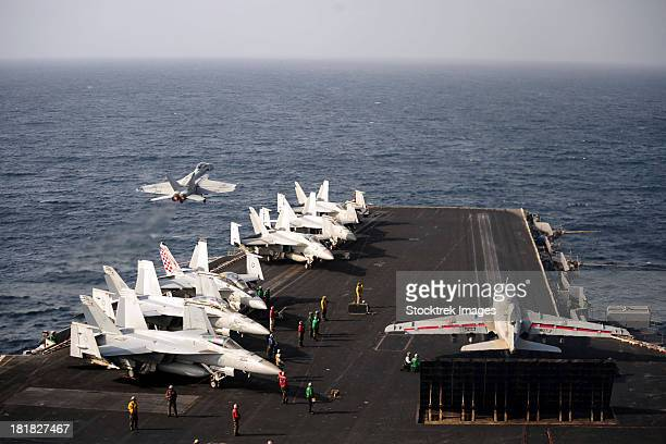 September 4, 2012 - The aircraft carrier USS Enterprise conducts flight operations in the Arabian Sea.