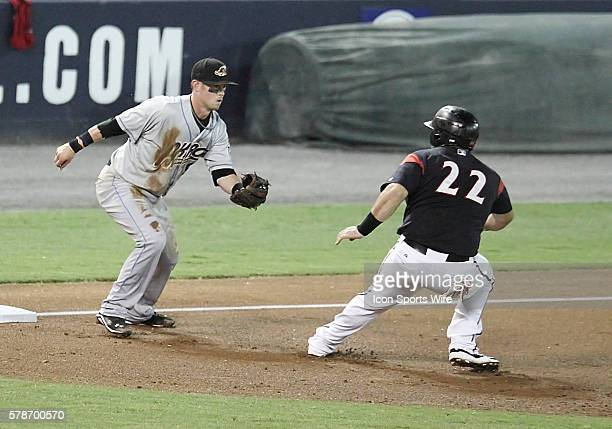 Richmond Flying Squirrels Catcher Tyler LaTorre gets caught between 2nd and 3rd by Akron Rubber Ducks Third Baseman Justin Toole Richmond Flying...