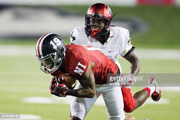 Northern Illinois wide receiver Kenny Golladay dives for extra yardage after a long pass reception during the Huskies game against UNLV at Brigham...