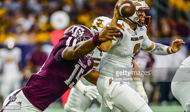 Texas AM Aggies defensive lineman Myles Garrett hits the arm of Arizona State Sun Devils quarterback Mike Bercovici forcing a fumble during the...