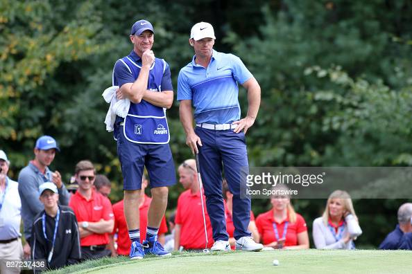 Paul Casey and his caddied scope out the putt on 18 for eagle at the Deutsche Bank Championship at the TPC Boston in Norton Massachusetts