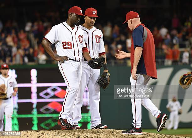 Washington Nationals manager Matt Williams takes the ball from relief pitcher Rafael Soriano after he gave up two home runs in the ninth inning to...