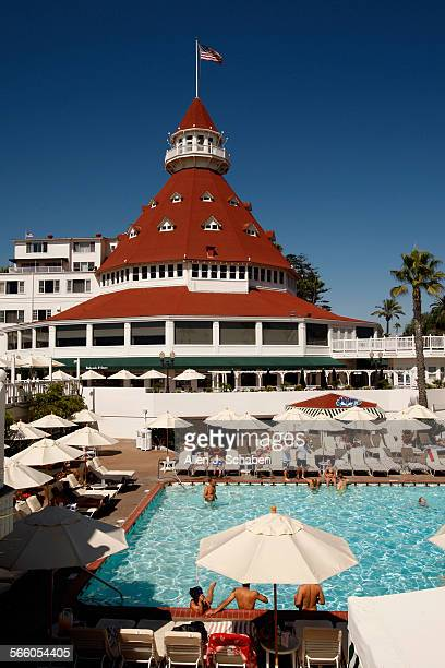 With an enchanting Victorian atmosphere people lounge poolside on a warm summer afternoon at the historic Hotel Del Coronado built in 1880 in...