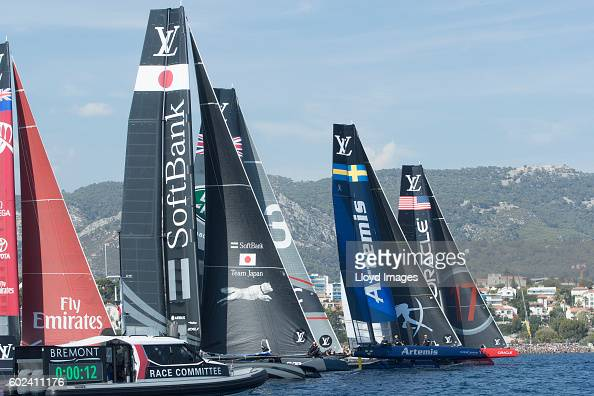 Softbank Team Japan skippered by Dean Barker and the fleet cross the start line during day four of The 35th America's Cup Louis Vuitton World Series...