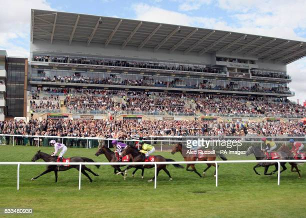 Septimus ridden by Johnny Murtagh in second place on the first lap as they pass the new stand on way to winning the Gner Doncaster Cup at Doncaster...
