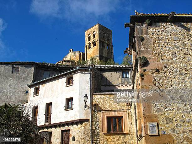 Sepulveda houses seen from the Barbican Street and tower of the El Salvador Church at the top Sepulveda Segovia Castile and Leon Spain