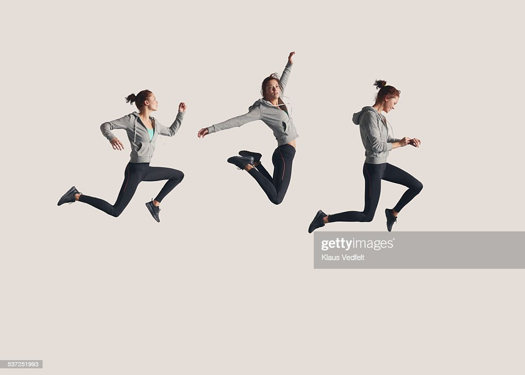 Sequence of female runner in the air : Stock Photo
