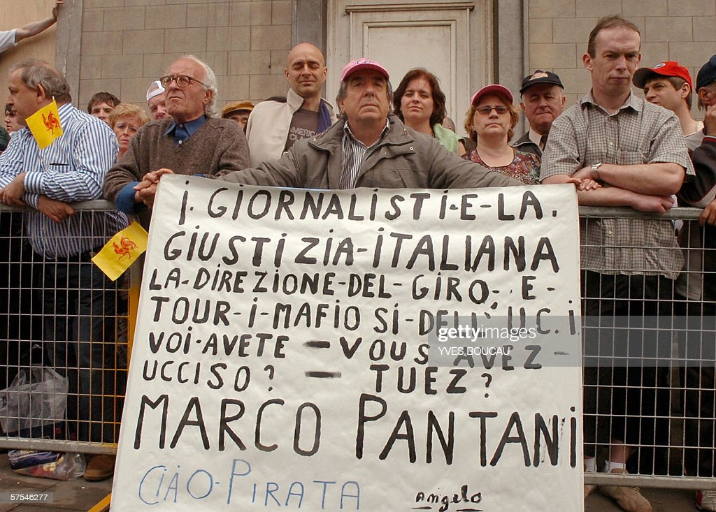 A protester holds a placard declaring,'Journalists and Italian justice, the Giro management and the mafias of the UCI (International U nion of Cycling), you killed Marco Pantani. Ciao, Priates. (Signed) Angelo', on the route of the prologue aof the Giro d'Italia (Tour of Italy) cycling race 06 May 2006, in Seraing. BELGA