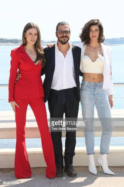 Seranay Sarikaya Mehmet Gunsur and Berak Tuzunatac attend 'Phi' Photocall during MIPTV 2017 on April 3 2017 in Cannes France