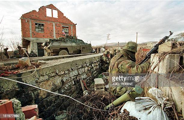 Serb forces stand on alert 21 February in the village of Studencane near Suva Reka in southern Kosovo one day after the Kosovo Liberation Army...