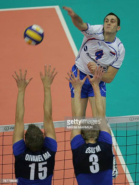 Serb Nikola Grbic attacks as Finland's Matti Oivanen and Mikko Esko block at the 2007 European Volleyball Championships final match in Moscow 16...