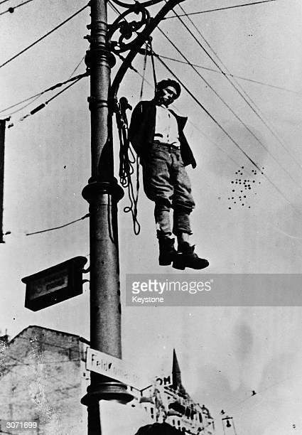 Serb patriot hangs from a pole on Nilocha Velikog Street Belgrade