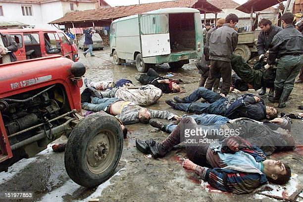 Serb police line the bodies of victims 29 January in a farmyard in the western Kosovo village of Rogovo Twentyfour ethnic Albanians all male most of...