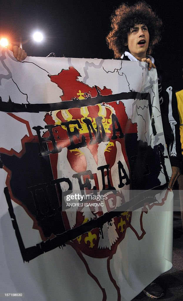 A Serb ultra nationalist youngster shows a map of Kosovo reading 'No surrender', during a rally to protest after a UN court cleared Kosovo's former prime minister Ramush Haradinaj of war crimes committed during the 1998-1999 conflict, in Belgrade on November 29, 2012. A UN war crimes court on November 29, cleared Haradinaj of murder and torture during the 1990s war of independence, enraging Belgrade with the second such acquittal in two weeks. The Hague-based International Criminal Tribunal for the former Yugoslavia (ICTY) cleared the former military commander and two of his former guerrilla comrades after a case that lasted seven years.