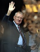 Serb ultranationalist leader Vojislav Seselj waves at supporters on November 12 2014 after arriving at his Radical Serb Party headquarters in Zemun...