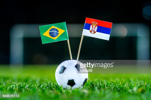 Serbia - Brazil, Group E, Wednesday, 27. June, Football, World Cup, Russia 2018, National Flags on green grass, white football ball on ground. : Stock Photo