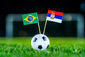 Serbia - Brazil, Group E, Wednesday, 27. June, Football, World Cup, Russia 2018, National Flags on green grass, white football ball on ground.