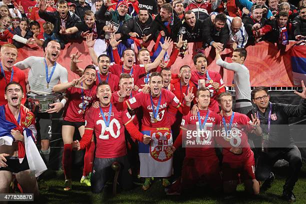 Serbia celebrate with the FIFA U20 trophy following the FIFA U20 World Cup Final match between Brazil and Serbia at North Harbour Stadium on June 20...