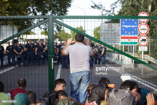 Serbia Horgos Refugees standing at the border gate with Hungary Hungary has been a major transit country for migrants many of whom aim to continue on...