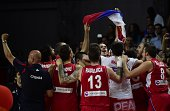 Serbia players celebrate their victory at the end of the 2014 FIBA World basketball championships semifinal match France vs Serbia at the Palacio de...