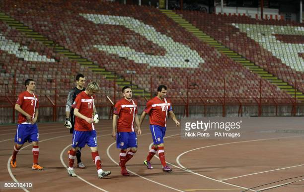Serbia players make their way out on to the pitch after the halftime interval