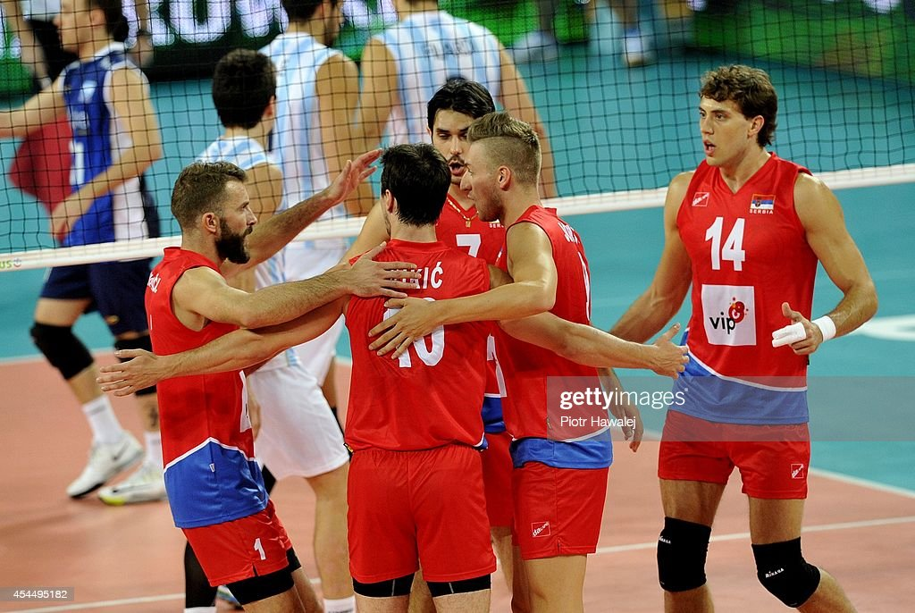 Serbia team celebrate after winning a point during the FIVB World Championships match between Serbia and Argentina on September 2, 2014 in Wroclaw, Poland.