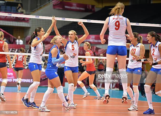 Serbia team cereblate after scoring a point during day two of the FIVB World Grand Prix Sapporo 2013 match between USA and Serbia at Hokkaido...