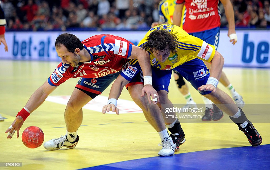Serbian Alem Toskic (L) fights for the ball with Swedish Andreas Nilsson (R) during the Men's EHF Euro 2012 Handball Championship match Serbia vs Sweden on January 23, 2012 at the Belgrade Arena.